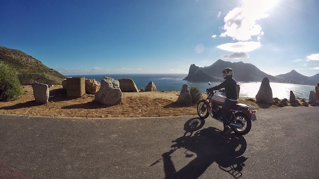 Wolf Moto admiring the views on their Moto Guzzi V7.